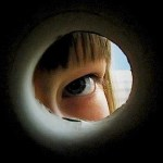 View of a child looking out a keyhole, limiting what can be seen