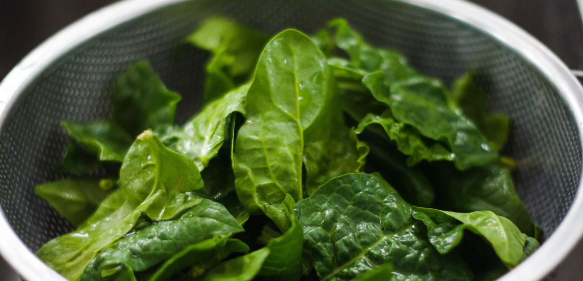 Leafy greens in a colander