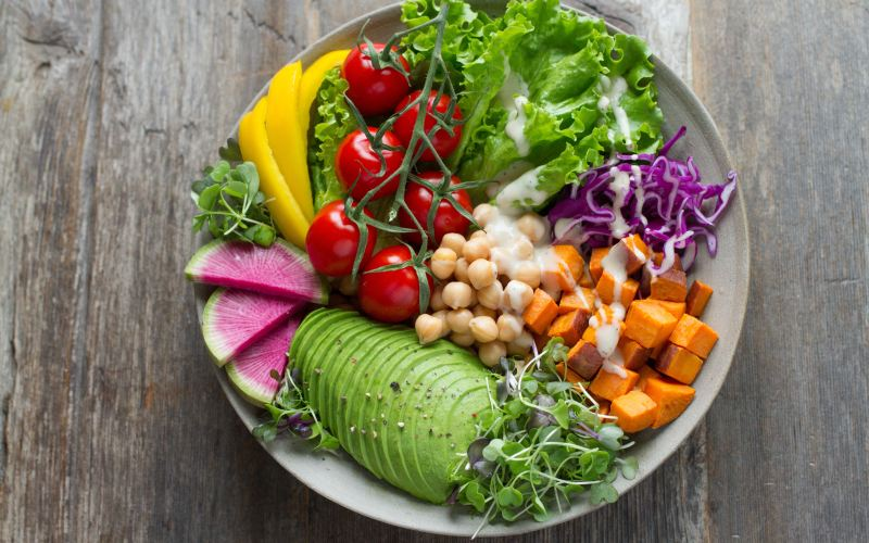 Buddha bowl salad on a wood table