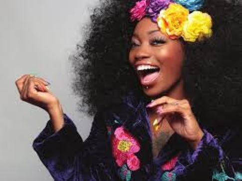 A laughing black woman passionate about her business