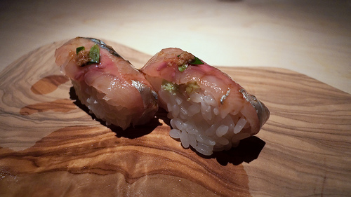 Aji nigiri with grated ginger and shiso at Naoe. Photo by Ed Fisher