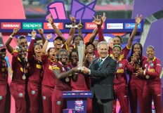 KOLKATA, INDIA - APRIL 3 : Captain of the West Indies Stafanie Taylor receives the Trophy with her team after winning the Women's ICC World Twenty20 India 2016 Final match between Australia and West Indies on April 03, 2016 in Kolkata, India. (Photo by Pal Pillai/IDI via Getty Images)