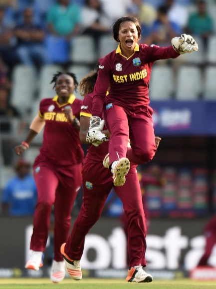West Indies wicketkeeper Merissa Aguilleira celebrates with teammates after winning the World T20 cricket tournament womens semi-final match against New Zealand at The Wankhede Cricket Stadium in Mumbai on March 31, 2016. / AFP / PUNIT PARANJPE (Photo credit should read PUNIT PARANJPE/AFP/Getty Images)