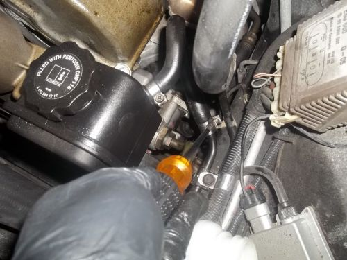 small resolution of detach return line from the power steering reservoir housing