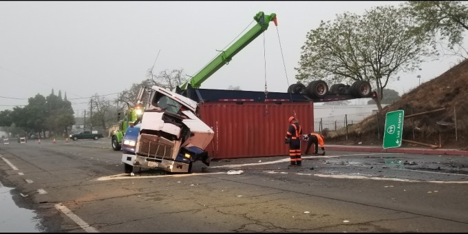 BIG RIG CRASHES DOWN FROM HIGHWAY 99 IN MERCED - Merced