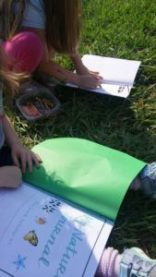 Girls coloring in nature journal