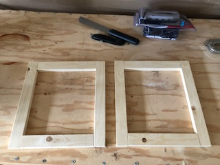 two screen printing frames laid out for stapling