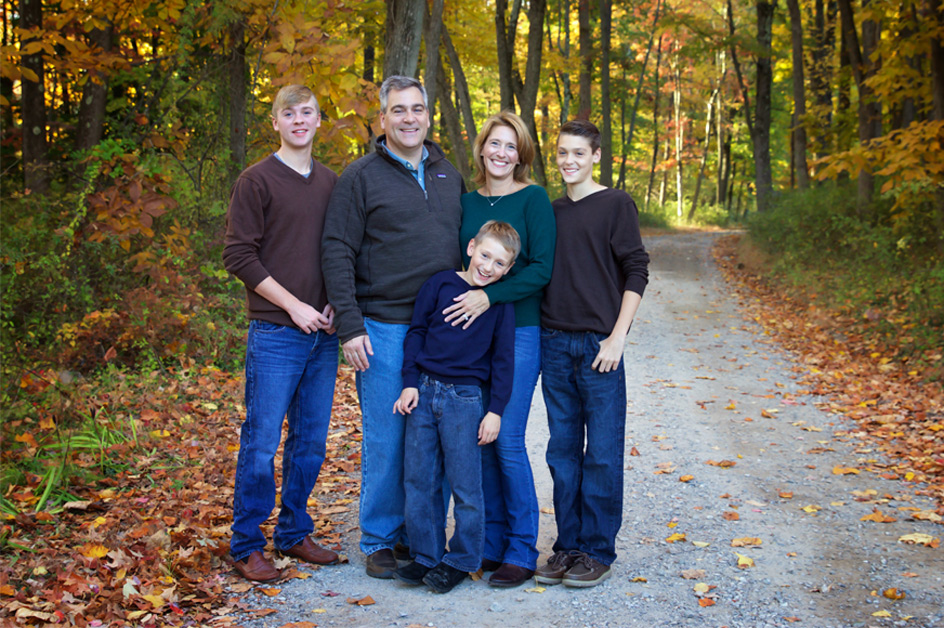 Geralyn Ritter with family in forest