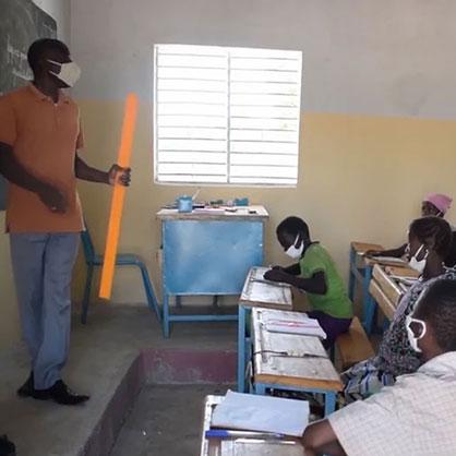 Teacher and his class in Burkina Faso