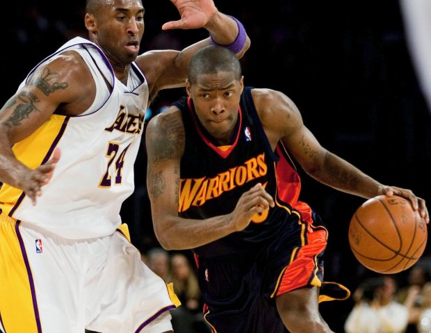 Golden State Warriors' Jamal Crawford drives to the basket while being guarded by Los Angeles Lakers' Kobe Bryant during the first half of an NBA basketball game on Sunday, Dec. 28, 2008, in Los Angeles. (AP Photo/Jeff Lewis)