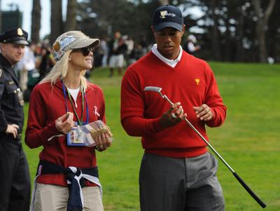 U.S. team members Tiger Woods chats with his wife Elin Nordegren while walking on the 14th hole during the first round of the 2009 President's Cup on Thursday, Oct. 8, 2009 at Harding Park Golf Course in San Francisco, Calif. (Jose Carlos Fajardo/Staff)