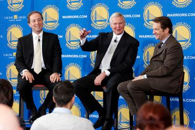 Golden State Warriors co-owners Joe Lacob, left, and Peter Gruber, right, announce Jerry West as the newest member to the Warriors' Executive Board during a press conference at the St. Regis Hotel in San Francisco, Calif. on Tuesday, May 24, 2011. (Laura A. Oda/Staff)
