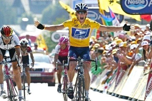 FILE - In this July 22, 2004, file photo, overall leader Lance Armstrong reacts as he crosses the finish line to win the 17th stage of the Tour de France cycling race between Bourd-d'Oisans and Le Grand Bornand, French Alps. Federal prosecutors said, Friday, Feb. 3, 2012, they are closing a criminal investigation of Armstrong and will not charge him over allegations the seven-time Tour de France winner used performance-enhancing drugs. (AP Photo/Laurent Rebours, File)