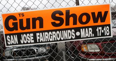 A sign promotes a gun show on a fence at the Santa Clara County Fairgrounds in San Jose, Calif., on Saturday, March 17, 2012. (Jim Gensheimer/Staff)