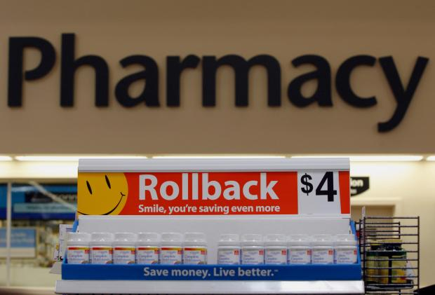 Vitamins are for sale in front of the pharmacy at a Wal-Mart Supercenter in Rogers, Ark.