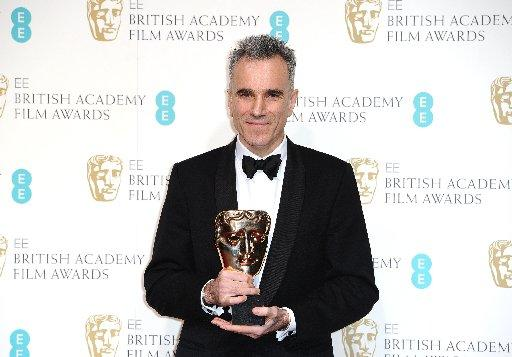"American actor Daniel Day-Lewis holds the award for Leading Actor for his role in ""Lincoln, "" at the BAFTA Film Awards at the Royal Opera House on Sunday, Feb. 10, 2013, in London. (Photo by Jonathan Short/Invision/AP)"