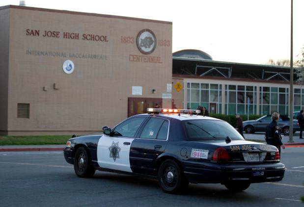 A San Jose police car outside of San Jose High School near where a homicide occurred on the 300 block of 21st street in San Jose, Calif., on Wednesday, Feb. 13, 2013. (Nhat V. Meyer/Staff)