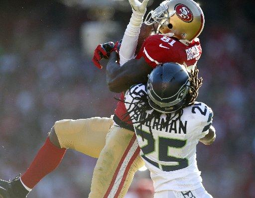 San Francisco 49ers' Anquan Boldin (81) comes down with a catch against Seattle Seahawks' Richard Sherman (25) in the second quarter at Candlestick Park in San Francisco, Calif. on Sunday, Dec. 8, 2013. (Nhat V. Meyer/Bay Area News Group)