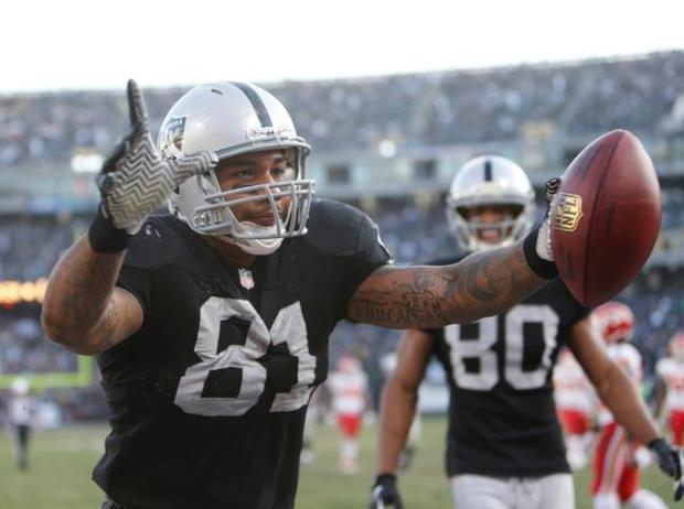 The Oakland Raiders' Mychal Rivera (81) celebrates a touchdown against the Kansas City Chiefs in the third quarter at O.co Coliseum in Oakland, Calif., on Sunday, Dec. 15, 2013. (Josie Lepe/Bay Area News Group)