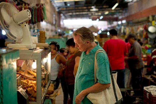 In this May 26, 2014 photo, American chef Jeremiah Tower shops for Yucatecan pork belly known as katakana, at the Central Market in Merida, Mexico. Tower made his name in the 70s at Chez Panisse, the famed Berkeley, Calif., restaurant that helped spawn the renaissance of American cooking focused on fresh, local ingredients. (AP Photo/Dario Lopez-Mills)