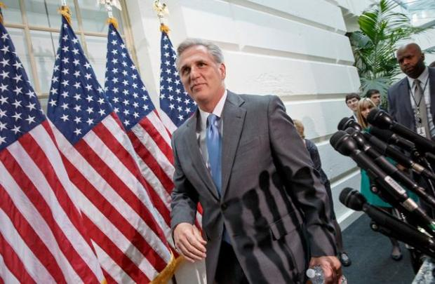 House Majority Whip Kevin McCarthy of Calif. leaves a Republican Conference meeting on Capitol Hill in Washington, Wednesday, June 18, 2014, as candidates vying for House GOP leadership posts make their pitches to the rank-and-file in the tumultuous aftermath of House Majority Leader Eric Cantor s sudden loss last week in his Virginia primary race. (AP Photo/J. Scott Applewhite)