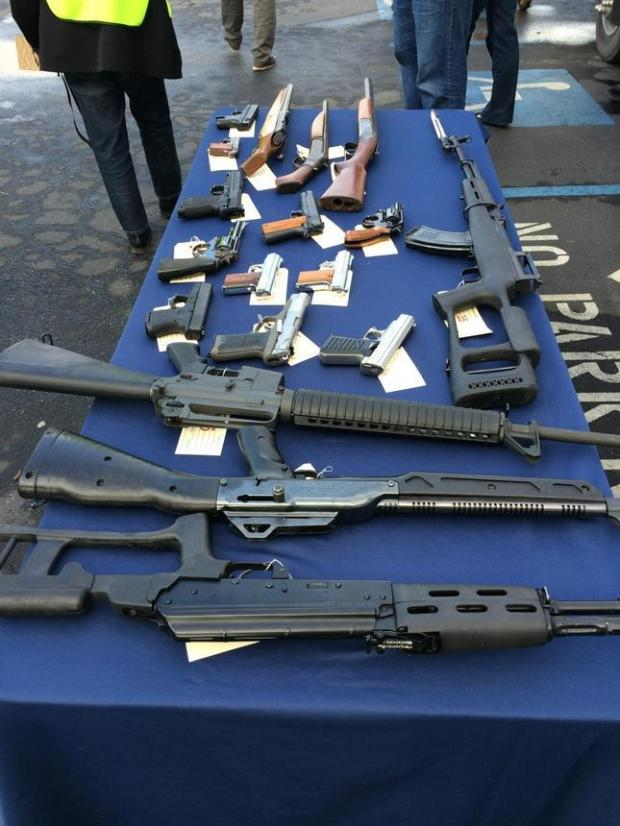 An array of weapons collected at San Jose's gun buyback event on Dec. 13, 2014 are shown.