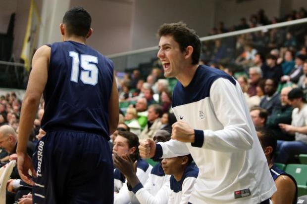 Nick Kerr, celebrates a basket as his San Diego Toreros teammate Thomas Jacob (15) walks past the bench against the University of San Francisco Dons at USF's War Memorial Gym in San Francisco, Calif., on Thursday, Jan. 1, 2015. Golden State Warriors head coach Steve Kerr and his wife Margot Kerr attended the game in which their son Nick didn't play during the Toreros 57-56 win. (Ray Chavez/Bay Area News Group)