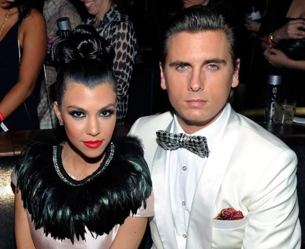 """Television personalities Kourtney Kardashian and Scott Disick attend the launch of AG Adriano Goldschmied's """"backstAGe presents:"""" initiative in Las Vegas February 14, 2011. Disick has entered rehab at the Rythmia Life Advancement Center in Costa Rica. (Photo by Ethan Miller/Getty Images for AG Adriano Goldschmied)"""