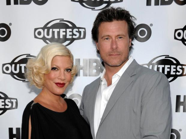 """FILE - In this July 7, 2011 file photo, actress Tori Spelling, left, and actor Dean McDermott arrive at the premiere of the feature film """"Gun Hill Road"""" in Los Angeles. Spelling is willing to go there for a second time. Lifetime says filming began Thursday, Sept. 11, 2014, on another season of """"True Tori."""" (AP Photo/Dan Steinberg, file)"""