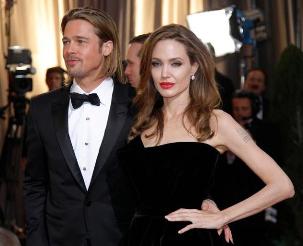 """Brad Pitt and Angelina Jolie are seen at the Academy Awards in Hollywood in 2012. The pair are starring together in a new movie, """"By the Sea,"""" directed by Jolie. A trailer of the drama has just been released. (AP Photo/Amy Sancetta, File)"""