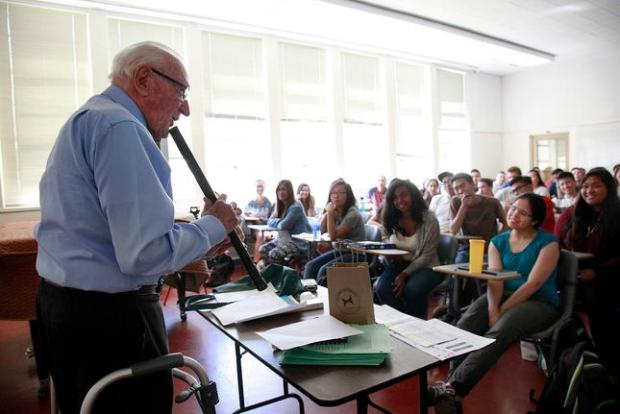 Gus Lease introduces a wind instrument to his music appreciation class on the first day of his 67th year teaching  at San Jose State University, on Monday afternoon, Aug. 24, 2015, in San Jose, Calif. (Karl Mondon/Bay Area News Group)