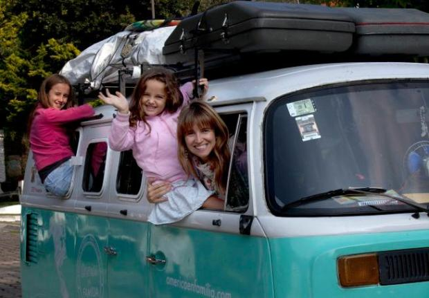 FILE - In this Aug. 22, 2015, file photo, in Mexico City, Noel Zemborain, 39, poses with two of her children, 12-year-old Cala, left, and 5-year-old Mia, in their 1980 Volkswagen van, which the family named Francisca. Zemborain and her husband Catire Walker piled their children into the van in March in Buenos Aires, Argentina, traveling 13,000 miles to see Pope Francis in Philadelphia and attend the Festival of Families. It took 194 days and 12 border crossings, but the family arrived on Monday, Sept. 21, 2015. (AP Photo/Marco Ugarte, File)