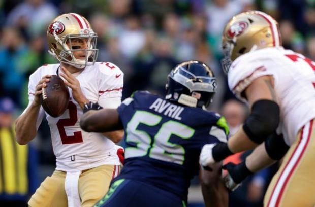 San Francisco 49ers quarterback Blaine Gabbert (2) looks downfield as Seattle Seahawks defensive end Cliff Avril (56) moves during the first half of an NFL football game, Sunday, Nov. 22, 2015, in Seattle. (AP Photo/John Froschauer)