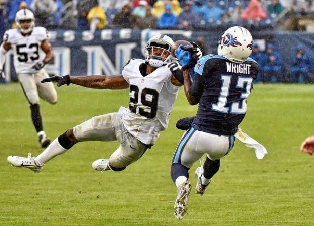 NASHVILLE, TN - NOVEMBER 29: David Amerson #29 of the Oakland Raiders defends the ball away from Kendall Wright #13 of the Tennessee Titans during the second half at Nissan Stadium on November 29, 2015 in Nashville, Tennessee. (Photo by Frederick Breedon/Getty Images)