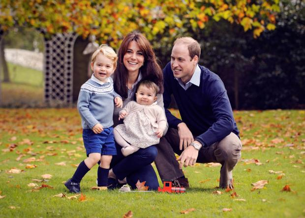 A handout picture obtained in London on December 18, 2015, shows Britain's Prince William (R), Catherine, Duchess of Cambridge (2nd L) and their two children Prince George (L) and Princess Charlotte in a photograph taken in late October 2015 at Kensington Palace in London. (AFP PHOTO/Chris Jelf)