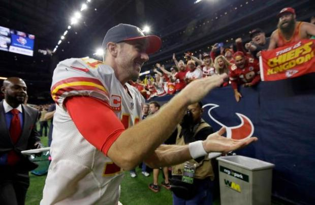 Kansas City Chiefs quarterback Alex Smith (11) runs off the field following an NFL wild-card playoff football game against the Houston Texans, Saturday, Jan. 9, 2016, in Houston. Kansas City won 30-0. (AP Photo/Tony Gutierrez)