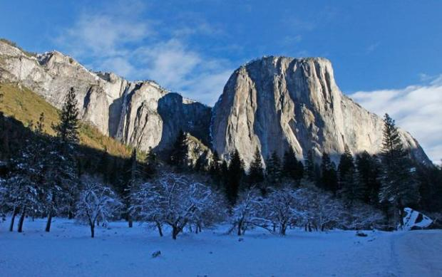 El Capitan shines in the afternoon sun above the snowy shadows of the valley floor in Yosemite National Park, Calif., on Wednesday, Dec. 30, 2015. (Laura A. Oda/Bay Area News Group)