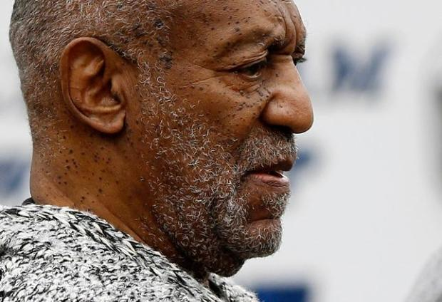 Bill Cosby, in December, leaves the Cheltenham Township Police Department where he was processed after being arraigned on a felony charge of aggravated indecent assault in Elkins Park, Pa. (AP Photo/Matt Rourke, File)
