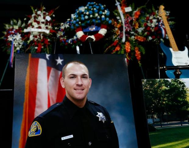 A portrait of San Jose Police Department Officer, Michael Katherman sits at the front of the stage before his memorial service at SAP Center in San Jose, Calif., on Tuesday, June 21, 2016. Katherman was killed in a traffic collision while on patrol on his police motorcycle last week. (Photo by Gary Reyes/Bay Area News Group)