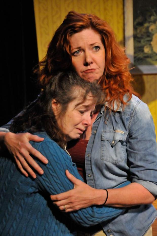 "Diana Tasca, left, and Betsy Kruse Craig perform together in The Pear Theatre's production of ""August: Osage County"" in 2016. (Ray Renati / Pear Theatre)"