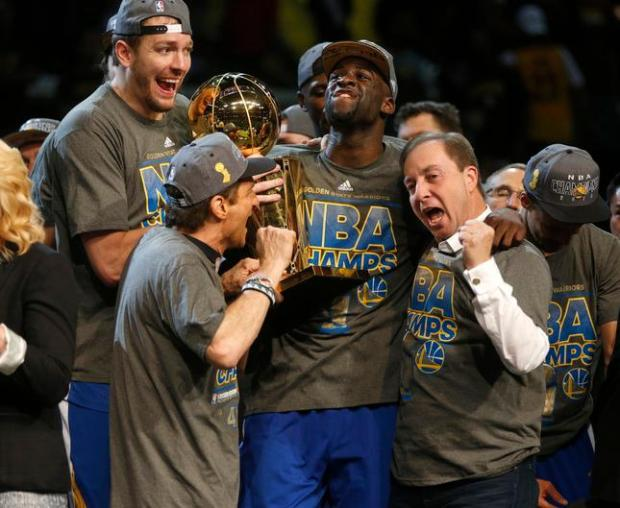 Golden State Warriors majority owner Joe Lacob celebrates with Golden State Warriors' David Lee (10) and Golden State Warriors' Draymond Green (23) after the Golden State Warriors 105-97 win over the Cleveland Cavaliers in Game 6 of the NBA Finals to win the NBA Championship at Quicken Loans Arena in Cleveland, Ohio, on Tuesday, June 16, 2015. (Nhat V. Meyer/Bay Area News Group)