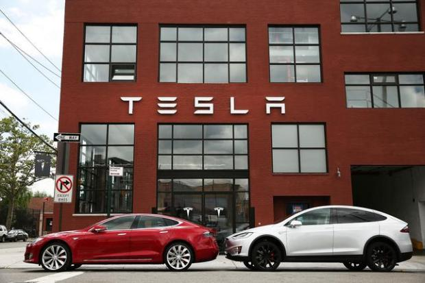 NEW YORK, NY - JULY 05:  Tesla vehicles sit parked outside of a new Tesla showroom and service center in Red Hook, Brooklyn on July 5, 2016 in New York City. The electric car company and its CEO and founder Elon Musk have come under increasing scrutiny following a crash of one of its electric cars while using the controversial autopilot service. Joshua Brown crashed and died in Florida on May 7 in a Tesla car that was operating on autopilot, which means that Brown's hands were not on the steering wheel. (Photo by Spencer Platt/Getty Images)