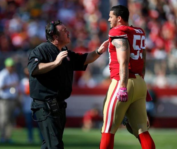 San Francisco 49ers head coach Jim Tomsula talks to San Francisco 49ers' Aaron Lynch (59) during their game against the Green Bay Packers in the third quarter of their NFL game at Levi's Stadium in Santa Clara, Calif., on Sunday, Oct. 4, 2015. (Nhat V. Meyer/Bay Area News Group)