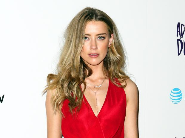 "In this April 12, 2016 photo, Amber Heard attends the LA Premiere of ""The Adderall Diaries"" in Los Angeles."
