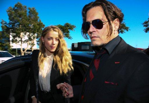 Amber Heard and Johnny Depp have reached an out-of-court settlement to end their 15-month marriage, reports said on August 16, 2016.