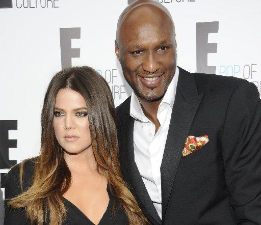In this April 30, 2012, photo, Khloe Kardashian Odom and Lamar Odom attend an E! Network upfront in New York.
