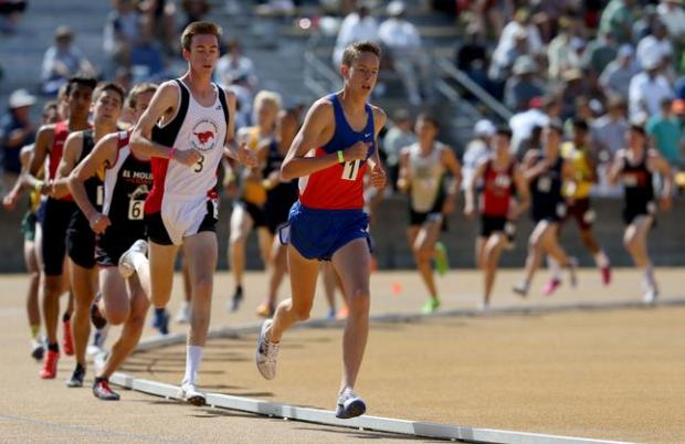Saint Joseph Notre Dame's Teare Cooper, right, leads Monte Vista's Timothy Chrisman, left, and the rest of the competitors in the boys 3200 meter run at the North Coast Section Meet of Champions at UC Berkeley in Berkeley, Calif., on Saturday, May 28, 2016. (Anda Chu/Bay Area News Group)