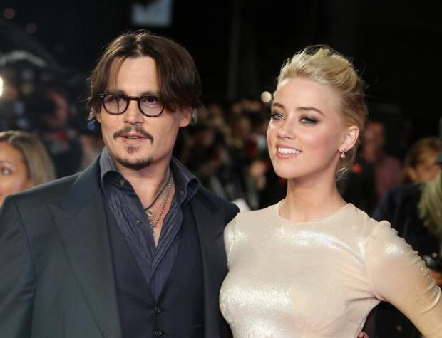 "Johnny Depp and Amber Heard arrive for the European premiere of their film, ""The Rum Diary,"" in London in 2011. (AP Photo/Joel Ryan, File)"