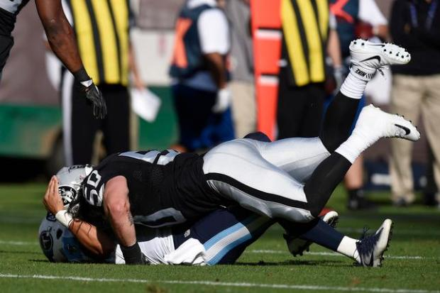 Oakland Raiders' Ben Heeney (50) tackles Tennessee Titans quarterback Marcus Mariota (8) after releasing the ball in the first quarter of their preseason game at the Coliseum in Oakland, Calif., on Saturday, Aug. 27, 2016. (Jose Carlos Fajardo/Bay Area News Group)