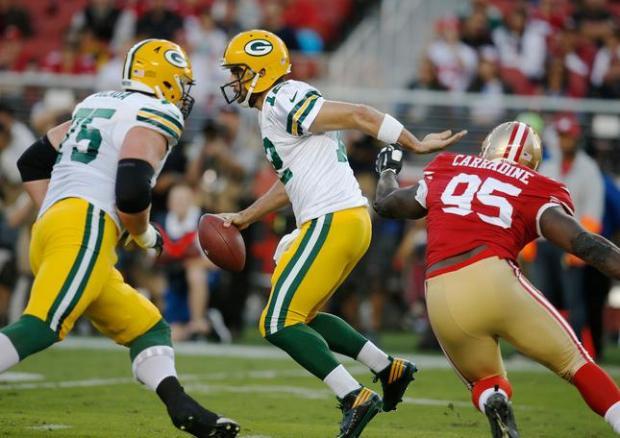 Green Bay Packers quarterback Aaron Rodgers (12) scrambles against San Francisco 49ers defensive tackle Tank Carradine (95) in the first quarter at Levi's Stadium Friday, Aug. 26, 2016, in Santa Clara, Calif. (Jim Gensheimer/Bay Area News Group)